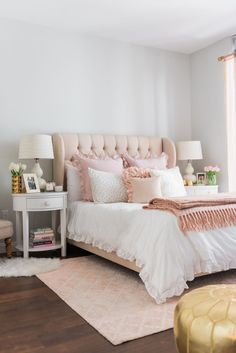 Warm shades of blush pink work lovely as accents in this room, along with clean, neutral whites and gray.