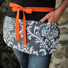 Utility Apron with Pockets in Smoke Gray Damask and Pumpkin Ties, Entertaining, Craft Shows or the Classroom - Vendor Utility Apron. $25.50, via Etsy.