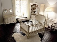 Love the dark floors and neutral colors of this nursery.  Perfect with the furry rug.