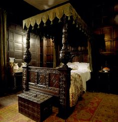 The interior of the Green Bedroom with its elaborate and ornately carved bed