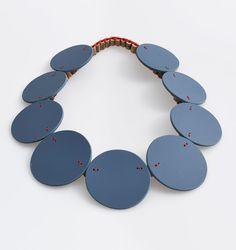 Silke Spitzer. Necklace: Grey round, 2015. Linoleum, elder, yarn. Photo by: Eric Tschernow.
