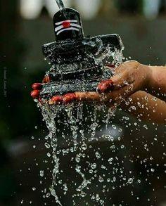 Shiva Linga being sanctified with element of water. Rudra Shiva, Mahakal Shiva, Om Namah Shivaya, Shiva Angry, Shiva Parvati Images, Krishna Images, Lord Murugan Wallpapers, Lord Shiva Family, Lord Shiva Pics