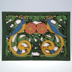 Wheatley Pottery radiator grill from the original Wheatley Pottery Showroom on Reading Road in Cincinnati. The grill features flowers and two birds of paradise along with open work to allow the passage of heated air. Antique art tile.
