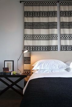 5 Headboards Made From Wall Hangings  I'm loving this bold, graphic print due to the solidity it lends.