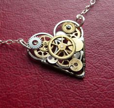 "Clockwork Heart Necklace ""Love Robotic"" Mother's Day Industrial Heart Steampunk Necklace Love Choker Sculpture by A Mechanical Mind. $50.00, via Etsy."