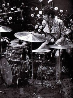 John Lennon on drums.