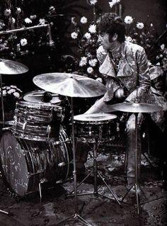 John Lennon on drums.