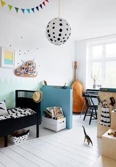 Colorful kids room for a boy with decorative and childish wall decorations.