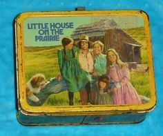 A lunchbox I had.  I used it to put my feet on & stabilize myself going over bumps on the bus.  One time, my dad (who drove) was flying so fast, I came down & put my foot through it, bending & ruining it- bye bye laura ingalls