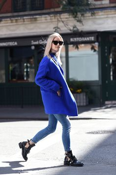 Designers Remix coat // Zara jeans (similar here) // Tommy Hilfiger turtle neck (similar here) // Balenciaga boots // Chanel bag // Celine sunglasses.