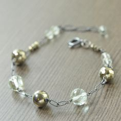 New today // One of a kind faceted gemstone bracelet. This bracelet features blackened sterling silver with links of faceted green amethyst and pyrite. #southpawstudios