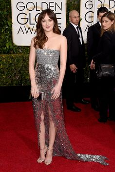 Dakota Johnson, in Chanel Haute Couture, with Jimmy Choo shoes. The 2015 Golden Globe Awards: Live From the Red Carpet - Gallery - Style.com