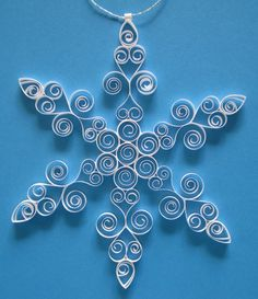 Ice Fancy white Christmas decoration: paper quilled snowflake ornament gift packaged Christmas ornament winter decoration. via Etsy.