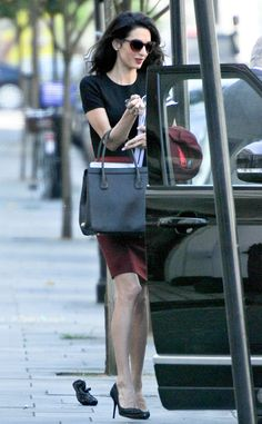The human rights lawyer looks fab while taking care of business in london. Amal Clooney, George Clooney, Office Fashion, Work Fashion, Fashion Ideas, Women's Fashion, Human Rights Lawyer, Burgundy Skirt, High Fashion Looks