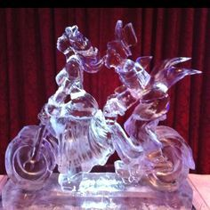 Custom tandem bicycle ice sculpture design for a wedding.