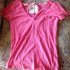 cute coral tee shirt This is such a cute T-shirt. Unfortunately I've outgrown it. Gently worn and super cute color for summer! Tops Tees - Short Sleeve