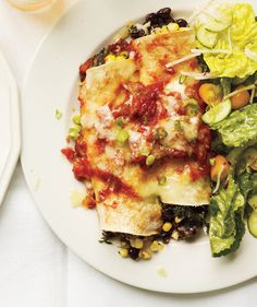 Slow-Cooker Bean and Spinach Enchiladas | Enchiladas may sound like a lot of work, but this version couldn't be easier. Just roll, then set it and forget it... until dinnertime, that is.