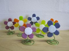 Fused glass flowers for any table, desk or shelf.