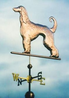 Standing Afghan Dog Weathervane by West Coast Weather Vanes.  This all copper Afghan Dog weathervane features a glass eye and distinctive tooling which gives the fur a realistic texture on the body.   Customers can provide photographs of their special canine pets for a customized  weather vane.