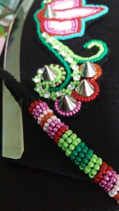 Bead embellished handbag by create beautiful beads. Beadwork in progress. Check it out at create beautiful beads on facebook.