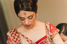 indian wedding bride getting dressed traditional http://maharaniweddings.com/gallery/photo/8264