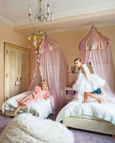 This little girls room features canopies from ABC Carpet and Home, and a faux-fur pouf.