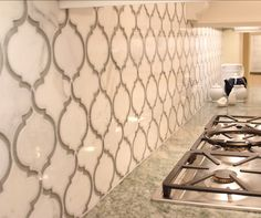 Kitchen Backsplash Ideas. Close up of Calcutta Marble (our counters) with gray glass tile inlay mosaic for backsplash.
