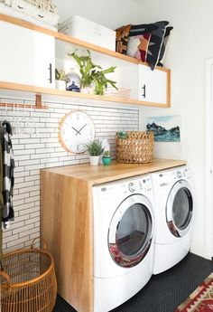 Add a wooden shelf above your washing machine + dryer to make a rustic + modern laundry room.