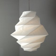 Fukurou by Issey Miyake, the play of shapes and light.  Fun to figure out!