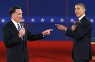 U.S. Republican presidential nominee Mitt Romney (L) and U.S. President Barack Obama gesture towards each other during the second U.S. presidential debate in Hempstead, New York, October 16, 2012. REUTERS/Mike Segar (UNITED STATES - Tags: POLITICS ELECTIONS USA PRESIDENTIAL ELECTION TPX IMAGES OF THE DAY)