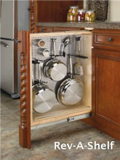 Full extension slide out (pull-out) cabinet organizers are base cabinet pull-outs which allow the items from the rear to be brought to the front to be easily reached. Pull-out shelves for pots and pans can be multi-tiered for extra storage. BASE PULL-OUT WITH PANEL & HANGERS For my small kitchen this would be great! I think I will look into it and see if I can get some or build some.