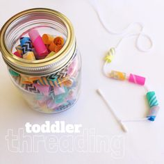 DIY Toddler Beads - jumbo straws covered in washi tape, & cut into 2cm lengths, use a q-tip for easy threading! www.acraftyliving.com