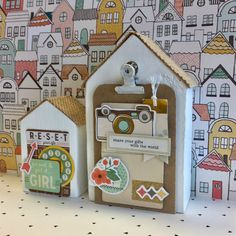 Altered small wooden houses with positive message.