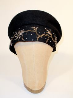Hattie Carnegie black felt hat with white beading and gold sequins (front view) | United States, 1940's