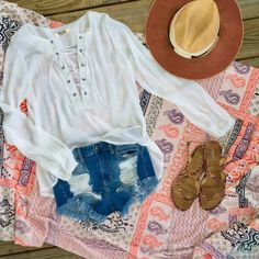 Be #beachblanket ready in this gauzy white Lace up top.     •    Gauzy cotton white lace up top with hi low Hem. The classic white shirt just got a fresh update with the lace up details. Outfits are limitless with this one. Paired with V-cut denim cutoffs ($36) and printed Aztec sandals ($10) Size small-large{Size up so it will be loose and Flowy}. $29/ships free    •    •    COMMENT or DM with size and email for secure PayPal invoice. •    •    •    •    •    •    #spring2017 #springstyle…