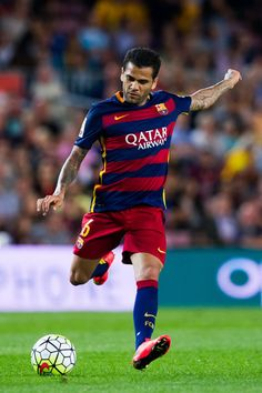 Dani Alves of FC Barcelona kicks the ball during the La Liga match between FC Barcelona and Levante UD at Camp Nou on September 20, 2015 in Barcelona, Catalonia.