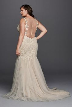 It can't get more romantic than this trumpet gown with a gorgeous beaded venice lace bodice, scalloped lace tank sleeves, v-neckline and an alluring button back detail. All wrapped up into one alluring wedding dress.  Galina Signature, exclusively for David's Bridal.  Also available in Regular,