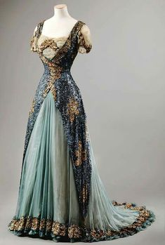 Stunning Evening Gown of Light Blue Lace, Gold-Embroidered, with Train.  (1910 - 1915)