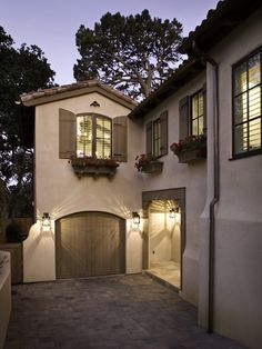 Yes - i like the arched shutters - i'll do them a light green the same color that i'm getting ready to paint my front door and definately add the wrought iron for decor and maybe tackle the flower boxes come next spring:)