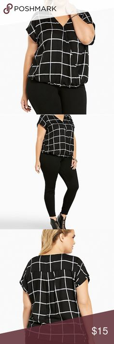 Torrid plaid dolman top Turn a good day into a plaid day. This black rayon twill top is chic beyond belief with a white plaid print. The surplice neckline makes your cleavage look amazing while concealing any tummy issues. The dolman sleeves are a voluminous contrast to the banded bottom.  Never worn but took tags off torrid Tops Blouses
