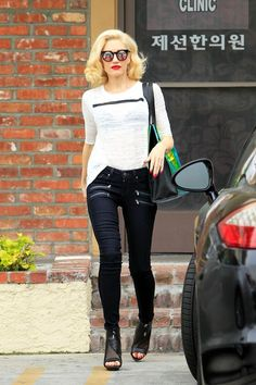 There's A Simple Formula Behind Gwen Stefani's Best Outfits  #refinery29  http://www.refinery29.com/2015/03/84103/gwen-stefani-best-outfits#slide-3  Every once in a while, Gwen will swap indigo for black. The zipper detail on this pair of jeans give her look a rock-and-roll edge, while the sky-high sandals add a dose of daytime glam. Gwen is wearing Paige jeans, L.A.M.B. shoes, and Quay Australia sunglasses. For a similar style, try: