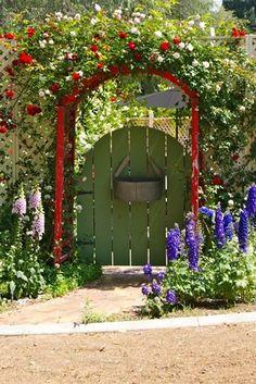 red garden arbor and green garden gate