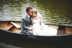 bride and groom in a canoe | photo: Geneoh Photography