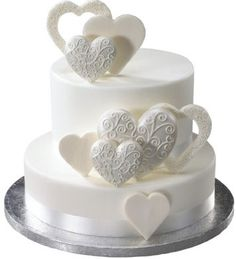 We want just a small cake for us and cupcakes for the guests - this would be a neat cake!