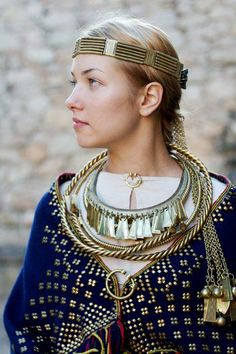 Latgallian dress and jewelry for future SCA Icelandic/Norse projects (I really don't know what that means but I'm leaving it on here).  Does she have enough swag or what?!