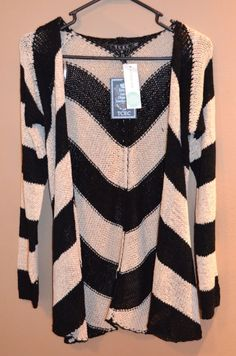 I like this sweater because it looks like it has some weight to the weave, has an interesting pattern and would go well with pretty much everything in my closet.