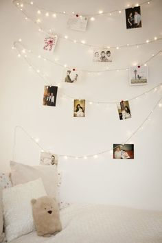 Clothespin pictures up on white Christmas lights. Pretty.