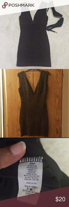 """Little black dress accented with gold NWT. Smoke and pet free home. Dress has a little stretch to give.   Bust-32"""" Waist-28"""" Lenght-33"""" ARP Dresses"""