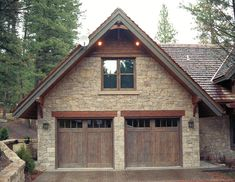 A nice example of double garage doors (2 single stall garage doors separated by wall on exterior only; interior garage open)
