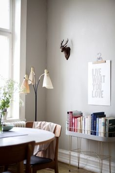 """Lina Ikse ... love this minimalist look. beautiful woodwork and paint. vintage planter used as """"book case""""."""